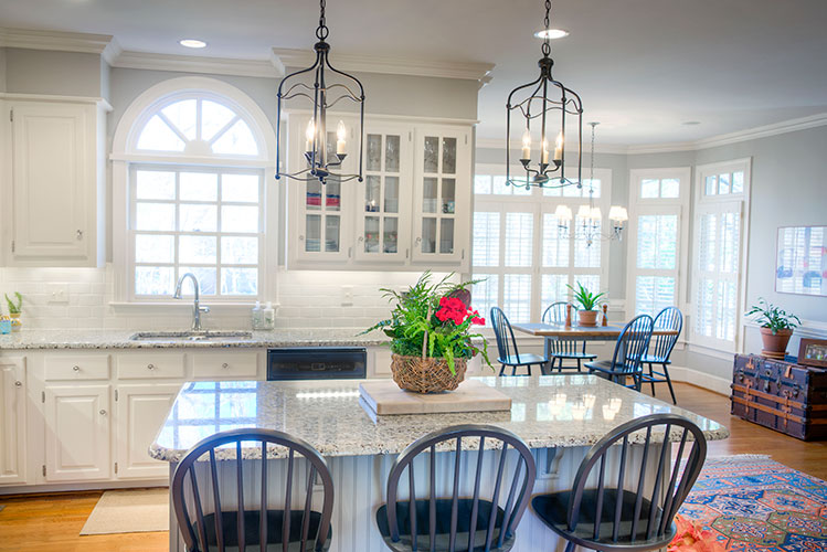 Cabell Cummins Interiors - Lanterns over kitchen island